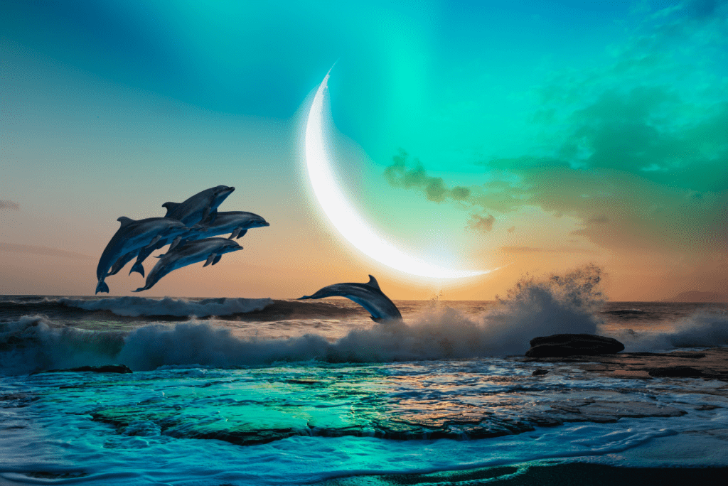 dolphins jumping out of the water with a moon in the back