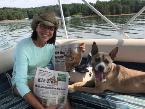 SARA practitioner Candace Solyst and her dog on a boat