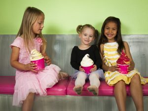 Young ballerinas having fun with frozen soft served yougurt.